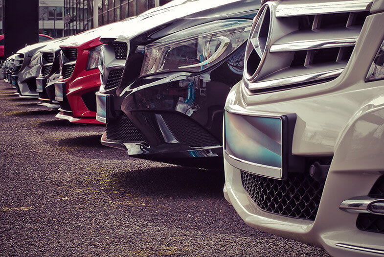 close up of a line of Mercedes-Benz cars