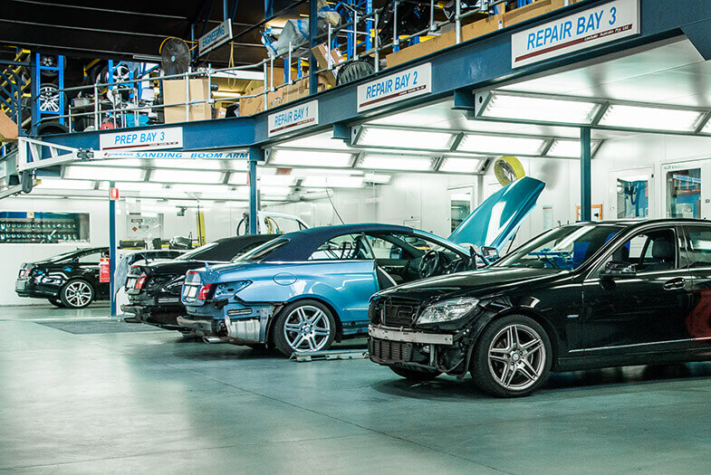 Luxury cars in service bays